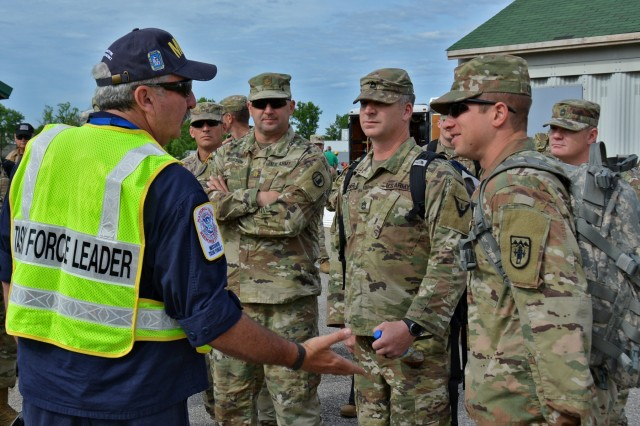 Chuck Leake, task force leader, Missouri Task Force One / Assistant Chief, Boone County Fire Protection District, briefs members of the Utah National Guard Homeland Response Force during a regional disaster training in Missouri, May 14-18, as part of the New Madrid Seismic Zone (NMSZ) exercise hosted by the Missouri National Guard. Multiple agencies participated in urban search and rescue operations in Columbia, Missouri, at the Boone County Fire Training Center responding as if the state had experienced a catastrophic 7.7 magnitude earthquake.