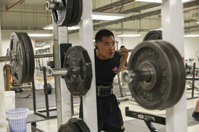 U.S. Army Sgt. Curtis Sua, an infantryman assigned to 2nd Infantry Brigade Combat Team, 4th Infantry Division, prepares to squat, May 17, 2018, during a workout session, May 17, 2018, at a physical fitness center on Kandahar Airfield, Afghanistan. Sua, a native of Las Vegas, Nevada, recently earned a spot as a member of the 1,000-pound club at the NATO physical fitness center. (U.S. Army photo by Staff Sgt. Neysa Canfield/TAAC-South Public Affairs)