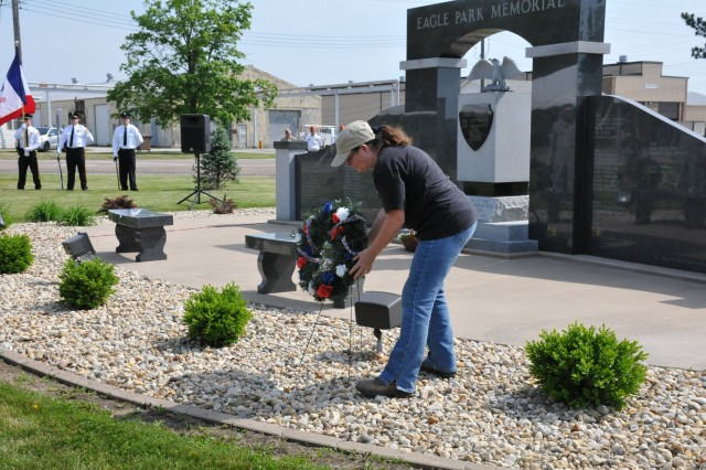 An American Ordnance employee lays a wreath during the Iowa Army Ammunition Plant's Memorial Ceremony, May 24.