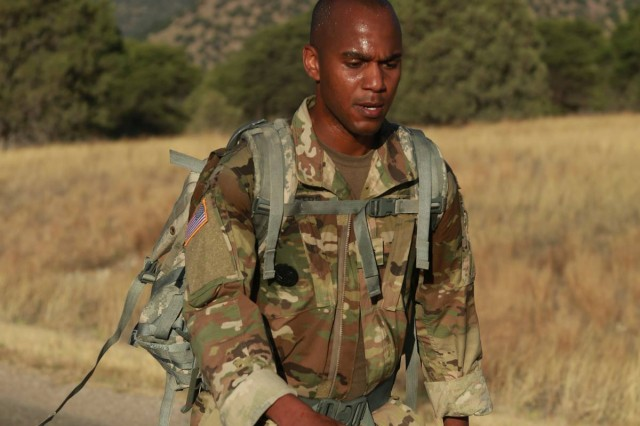 Sgt. 1st Class Deon Myers, NETCOM's NCO of the Year, nears the end of the 12-mile road march during the command's best warrior competition, Fort Huachuca, Ariz., which ran from May 18 through May 24.