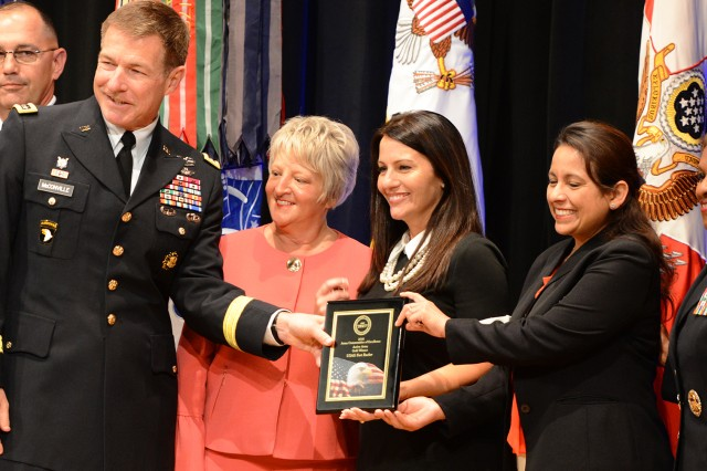Vice Chief of Staff of the Army Gen. James C. McConville presents the gold award to Fort Rucker officials at the Army Communities of Excellence Awards ceremony at the Pentagon May 18. Lt. Gen. Gwen Bingham, assistant chief of staff for Installation Management (right), also participated in the ceremony.