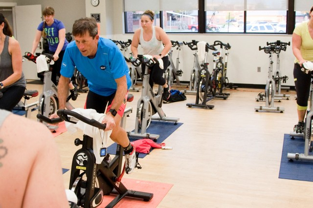 Nicole Crowley, fitness program coordinator, leads a recent class through an indoor cycling workout routine.