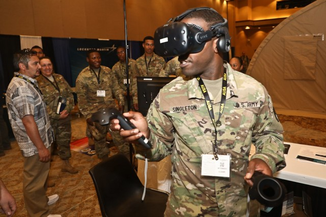 A Soldier tests out hands on technology at the e sixth annual Association of the United States Army (AUSA) Land Forces of the Pacific (LANPAC) Symposium May 22 through May 24.Photo By U.S. Army Staff Sgt. Keith Anderson, 25th Infantry Division Public Affairs