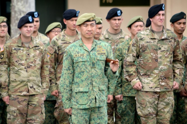 Third Warrant Officer K. L. Goh, assigned to 9th Division, Singapore Army, stands before a formation consisting of Soldiers U.S. Army and Singapore Army during the closing ceremony for Tiger Balm 18 at the 298th Regiment, Multi-Functional Training Unit (MFTU), Regional Training Institute (RTI), Waimanalo, Hawaii, on May 26, 2018. Tiger Balm is an annual bilateral military exercise designed to enhance the professional relationship, combat readiness, and interoperability between the US and Singapore, and fulfill and demonstrate regional security partnership and resolve. (U.S. Army photo by Staff Sgt. Armando R. Limon, 3rd Brigade Combat Team, 25th Infantry Division)