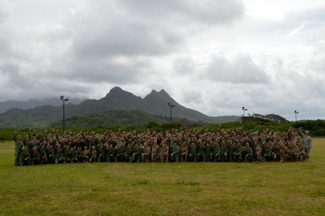 U.S. Soldiers assigned to the 3rd Brigade Combat Team, 25th Infantry Division; the 29th Infantry Brigade Combat Team, Hawaii Army National Guard; 426th Civil Affairs Battalion, California Army National Guard, and Singapore Soldiers assigned to the 6th Division, Singapore Army and 10th Singapore Infantry Brigade stand together for a closing ceremony photo for Tiger Balm 18 at the 298th Regiment, Multi-Functional Training Unit (MFTU), Regional Training Institute (RTI), Waimanalo, Hawaii, on May 26, 2018. Tiger Balm is an annual bilateral military exercise designed to enhance the professional relationship, combat readiness, and interoperability between the US and Singapore, and fulfill and demonstrate regional security partnership and resolve. (U.S. Army photo by Staff Sgt. Armando R. Limon, 3rd Brigade Combat Team, 25th Infantry Division)
