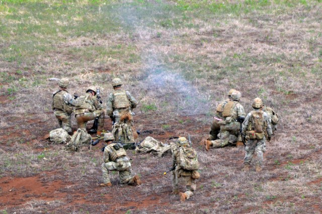 A mortar team assigned to the 2nd Battalion, 27th Infantry Regiment, 3rd Brigade Combat Team, 25th Infantry Division, conduct a fire mission with a M224 60 mm Lightweight Mortar during a live fire exercise for Tiger Balm 18 at Schofield Barracks, Hawaii, on May 23, 2018. Tiger Balm is a bilateral exercise held yearly between the U.S. and Singapore armies. (U.S. Army photo by Staff Sgt. Armando R. Limon, 3rd Brigade Combat Team, 25th Infantry Division)