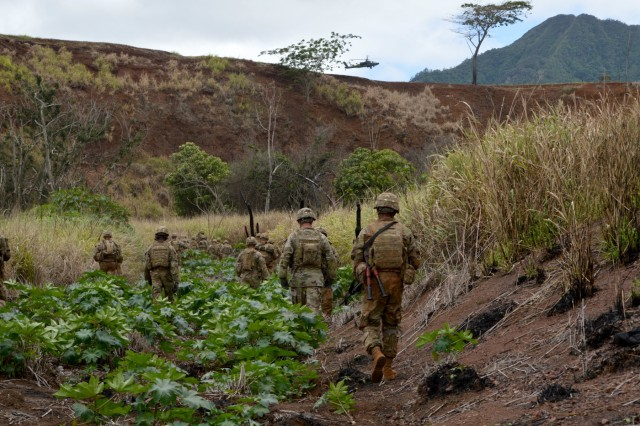Soldiers assigned to 2nd Battalion, 27th Infantry Regiment, 3rd Brigade Combat Team, 25th Infantry Division, maneuvers inside a gulch during a live fire exercise for Tiger Balm 18 at Schofield Barracks, Hawaii, on May 23, 2018. Tiger Balm is a bilateral exercise held yearly between the U.S. and Singapore armies. (U.S. Army photo by Staff Sgt. Armando R. Limon, 3rd Brigade Combat Team, 25th Infantry Division)