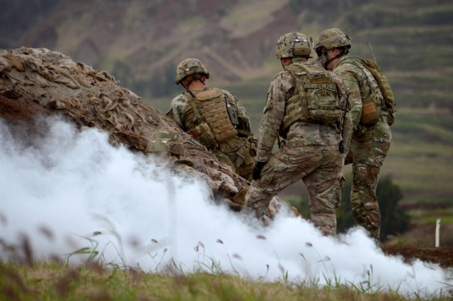 Soldiers assigned to 2nd Battalion, 27th Infantry Regiment, 3rd Brigade Combat Team, 25th Infantry Division, prepare to demolish a bunker during a live fire exercise for Tiger Balm 18 at Schofield Barracks, Hawaii, on May 23, 2018. Tiger Balm is a bilateral exercise held yearly between the U.S. and Singapore armies. (U.S. Army photo by Staff Sgt. Armando R. Limon, 3rd Brigade Combat Team, 25th Infantry Division)
