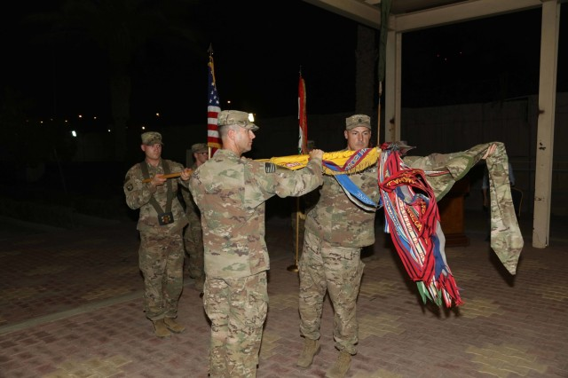 "Col. Jonathan Byrom and Command Sgt. Maj. Adam Nash uncase the colors of the 3rd Cavalry Regiment ""Brave Rifles"" during a transfer of authority ceremony in Baghdad, Iraq, May 28, 2018. The Brave Rifles assumed the mission from the 3rd Brigade Combat Team ""Patriots,"" 10th Mountain Division, and will support the Combined Joint Task Force - Operation Inherent Resolve, working by, with and through Iraqi Security Forces and coalition partners to defeat ISIS in designated areas of Iraq and Syria. (Photo by Spc. Avery Howard, Combined Joint Task Force - Operation Inherent Resolve Public Affairs)"