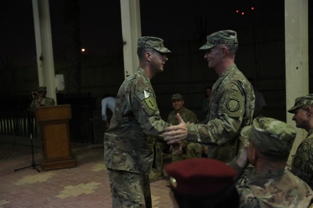"Col. Jonathan Byrom, commander of the 3rd Cavalry Regiment ""Brave Rifles,"" shakes hands with Maj. Gen. Walter E. Piatt, 10th Mountain Division commanding general and Combined Joint Task Force - Operation Inherent Resolve deputy commanding general, during a transfer of authority ceremony in Baghdad, Iraq, May 28, 2018. The Brave Rifles assumed the mission from the 3rd Brigade Combat Team ""Patriots,"" 10th Mountain Division, and will support the Combined Joint Task Force - Operation Inherent Resolve, working by, with and through Iraqi Security Forces and coalition partners to defeat ISIS in designated areas of Iraq and Syria. (U.S. Army photo by Master Sgt. Horace Murray)"