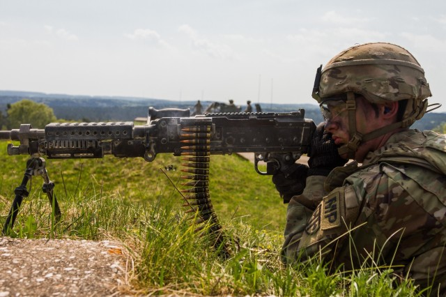 A soldier from the 709th Military Police Battalion zeros in on the target during the battalion's live fire exercise in preparation for Saber Strike 18.
