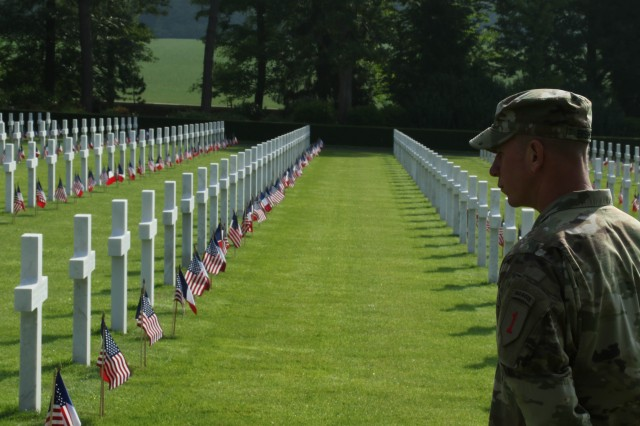 Commemorating origins of America's First Division 'Big Red One' Soldiers walk along battlefield