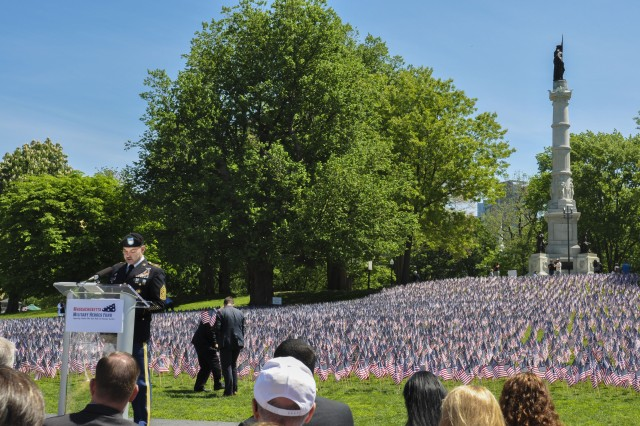 Command Sgt. Maj. Michael Pintagro, the USAG Natick Command Sgt. Major, speaks at the Remembering and Honoring Massachusetts Military Heroes ceremony May 24. During the ceremony, gold star families and military members read the names of fallen. Pintagro read 10 names.