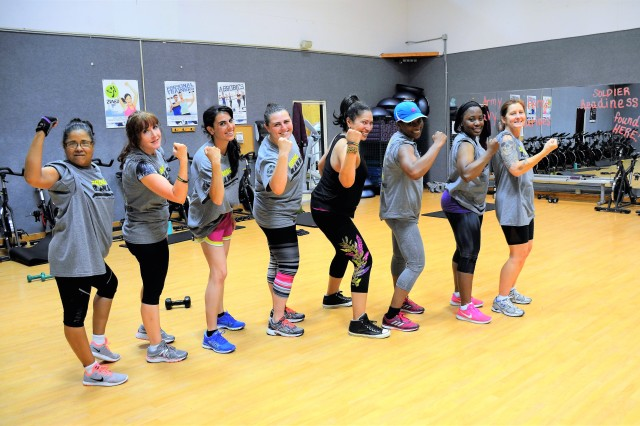 (Pictured from left): Noris Edington, Jennifer Morgan, Amanda Hartman, Danielle Martinez, Ina Keazer De Aponte, instructor, Tanya Bowman, Dorothy Francois and Pam Collins, show off their Strong B.A.N.D.S. T-shirts and wristbands following a Ripped class May 26 at Davidson Fitness Center, Fort Leonard Wood, Missouri. Ripped is an interval, power, plyometric, and endurance-based class that includes cardio, weight training and mixed martial arts. The Ripped class was held as part of Strong B.A.N.D.S. (Balance, Activity, Nutrition, Determination, and Strength) Weekend, where Davidson Fitness Center offered group fitness classes to appeal to many interests and fitness levels.