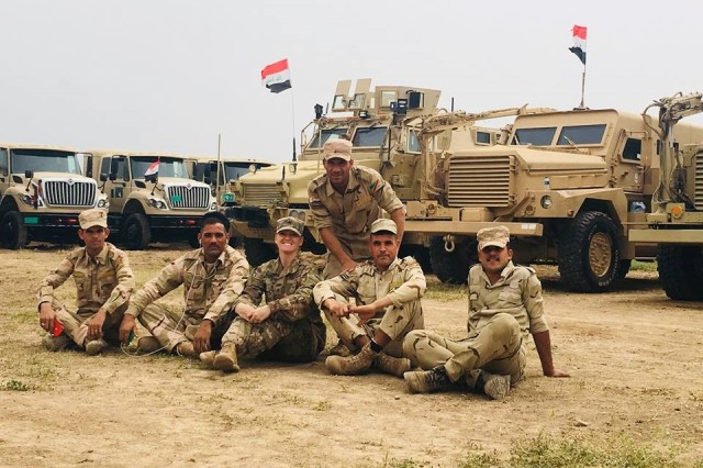 CAMP TAJI, Iraq — Staff Sgt. Samantha Perez (center) with the 1st Battalion, 35th Armored Regiment, 2nd Armored Brigade Combat Team, Task Force Spartan, and soldiers with the 9th Iraqi Armored Division pose for a photo April 13, 2018. The 1-35 is deployed in support of Combined Joint Task Force-Operation Inherent Resolve, to enable its Iraqi partners through the advise and assist mission. (U.S. Army photo by Staff Sgt. Adriana M. Diaz-Brown)
