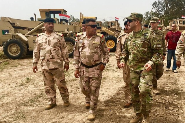 180413-A-BR501-062 CAMP TAJI, Iraq — Lt. Gen. Qasim, commander of the 9th Iraqi Armored Division (center), and Lt. Col. Alexis Rivera (right), commander of the 1st Battalion, 35th Armored Regiment, inspect the wheeled vehicle fleet in preparation for the chief of staff and Iraqi Joint Forces visit for the Victory Campaign on April 13, 2018. The 1-35 Armor, 2nd Armored Brigade Combat Team, Task Force Spartan, is deployed in support of Combined Joint Task Force-Operation Inherent Resolve, to enable its Iraqi partners through the advise and assist mission. (U.S. Army photo by Staff Sgt. Adriana M. Diaz-Brown)