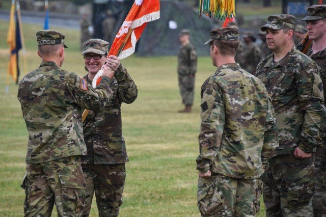 U.S. Army Col. Carl Worthington, left, commander of the 2nd Theater Signal Brigade, passes the unit colors to Lt. Col. Heather McAteer as she takes command of the 44th Expeditionary Signal Battalion during a change of command ceremony at Tower Barracks, Grafenwoehr, Germany, May 24, 2018. (U.S. Army photo by Markus Rauchenberger)