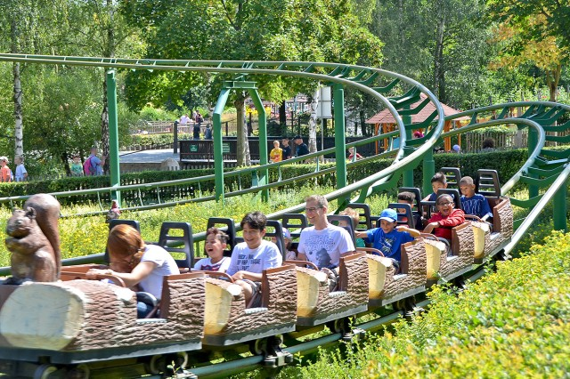 Children enjoy a roller coaster ride at the Lochmuehle Amusement Park during a School Age Center summer trip.