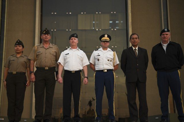 Members of the Peruvian Army pose for a photo alongside Maj. Gen. James A. Hoyer, the West Virginia National Guard Adjutant General, Col. Edward Ortiz, Army Defense Attache for the U.S. Embassy in Peru, and Command Sgt. Maj. James L. Allen, WVNG senior enlisted leader, outside the Peruvian Army Headquarters in Lima, Peru Jan. 31, 2018.