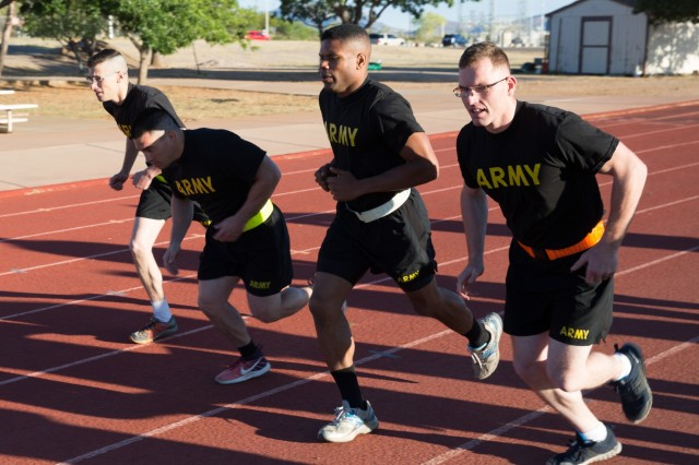 Competitors in the U.S. Army Intelligence Center of Excellence and Fort Huachuca's 2018 Best Warrior Competition start the 2-mile run portion of the Army Physical Fitness Test.