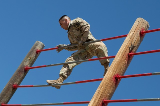 Staff Sgt. William Smithe, from the 344th Military Intelligence Battalion located at Goodfellow Air Force Base, Texas, clears the top of the obstacle during the U.S. Army Intelligence Center of Excellence and Fort Huachuca's 2018 Best Warrior Competition.