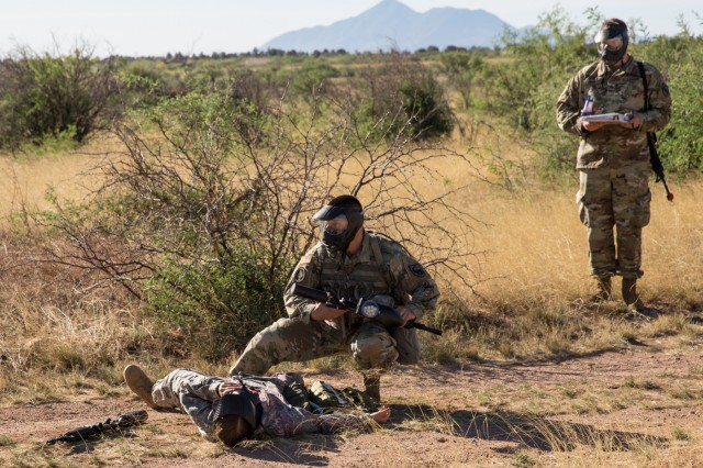 Staff Sgt. William Smithe, from the 344th Military Intelligence Battalion, prepares to treat a casualty during the Tactical Combat Casualty Care Station during the U.S. Army Intelligence Center of Excellence and Fort Huachuca's 2018 Best Warrior Competition.