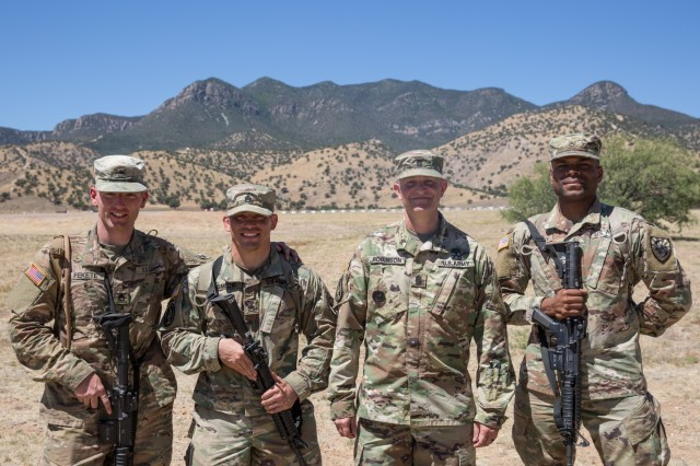 Command Sgt. Maj. Warren Robinson, Command Sergeant Major of the U.S. Army Intelligence Center of Excellence and Fort Huachuca, (second from the Right) stands with the finishers of the U.S. Army Intelligence Center of Excellence and Fort Huachuca's 2018 Best Warrior Competition.