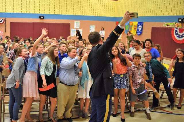 Capt. Thornton Ray, the operations officer (S-3) for the 1st Area Medical Laboratory, 20th Chemical, Biological, Radiological, Nuclear, Explosives (CBRNE) Command, takes a selfie with the fifth grade patriots after his speech at the annual Churchville Elementary School Fifth Grade Patriot Assembly on Thursday, May 24. Student participation in the Patriot Program is voluntary. Those who join must complete several requirements, including quizzes on subjects such as the American flag, U.S. geography, and U.S. government; composing a two-page report on a famous patriot; completing a community service project; and choosing a six-hour that demonstrate significant planning and work.
