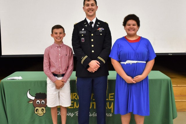 Capt. Thornton Ray, the operations officer (S-3) for the 1st Area Medical Laboratory, 20th Chemical, Biological, Radiological, Nuclear, Explosives (CBRNE) Command, poses for a photo with fifth graders Alicia Pembroke and Jack Geyer after his speech at the annual Churchville Elementary School Fifth Grade Patriot Assembly on Thursday, May 24. Pembroke and Geyer completed the Patriot Program by meeting all the requirements (see attached article). Pembroke recited the Gettysburg Address and Geyer wrote a Patriot report on Jenny Wade, the only civilian killed during the battle of Gettysburg.