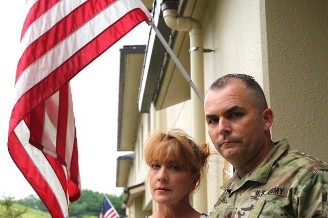 Wendy Holland, left, and Command Sgt. Maj. Will Holland, command sergeant major of U.S. Army Garrison Japan, stand together as parents in front of their home for a photo in memory of their late son Robert Sanchez. (U.S. Army photo by Lance D. Davis)