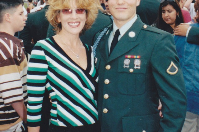 Wendy Holland, left, pictured with her son Pfc. Robert Sanchez, right, after his graduation from Infantry School. (Photo courtesy of Command Sgt. Maj. Will Holland)
