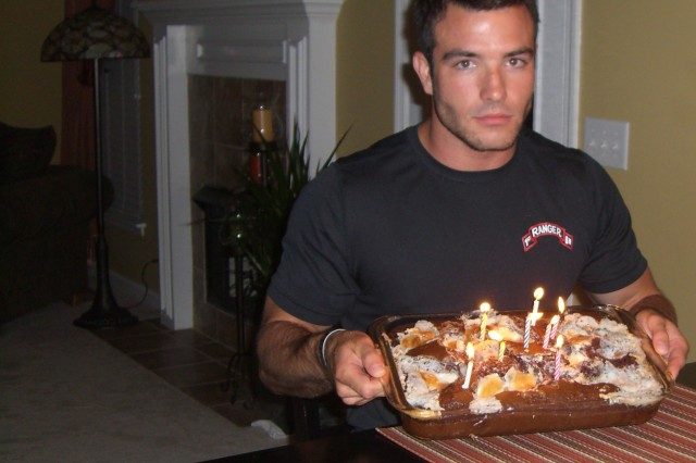 Robert Sanchez holds his cake for his 24th birthday July 19, 2009 at his parents' home in Nashville, Tn. during his last visit before deploying to Afghanistan. This was the first and last birthday that Sanchez's family celebrated with him since he joined the military. Sanchez was killed Oct. 1, 2009 in Afghanistan after completing a combat mission. (Photo courtesy of Command Sgt. Maj. Will Holland)