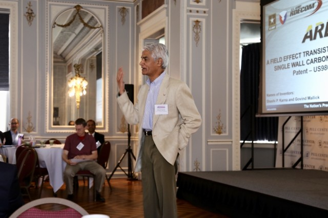 Dr. Shashi Karna, a nanotechnology physicist at the U.S. Army Research Laboratory, explains commercial applications of his patented carbon nanotube technology at a tech showcase in Newport, Rhode Island, on May 24.