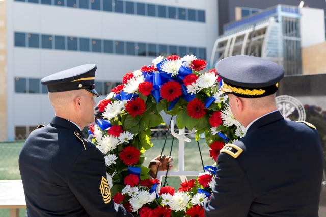 (Right to left) Maj. Gen. Christopher S. Ballard, commanding general, U.S. Army Intelligence and Security Command (INSCOM) and Command Sgt. Maj. Eric M. Schmitz place a ceremonial wreath on the INSCOM Memorial in honor of the fallen Soldiers of INSCOM during the 2018 INSCOM Memorial Day observance ceremony outside the Nolan Building, Fort Belvoir, Virginia, May 24.