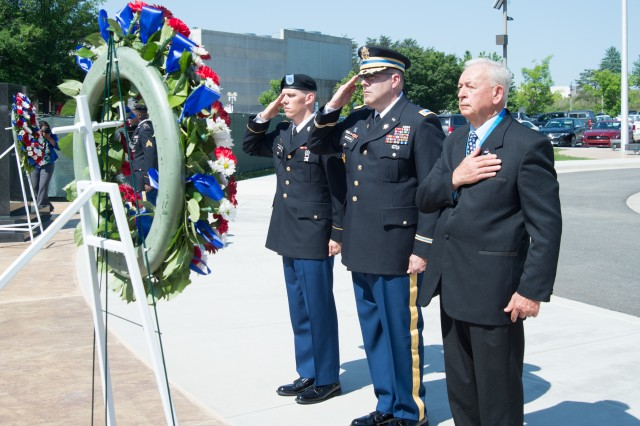 (Left to right) Spc. Zachary C. Grasee, military police assigned to the U.S. Army Intelligence and Security Command (INSCOM), Command Chief Warrant Officer Kevin G. Boughton and retired Chief Warrant Officer 4  Allan L. Lindley pay their respects after laying a ceremonial wreath in front of the Army Security Agency (ASA) Memorial honoring personnel who made the ultimate sacrifice in defense of our nation during the 2018 INSCOM Memorial Day observance ceremony outside the Nolan Building, Fort Belvoir, Virginia, May 24. The ASA was INSCOM's predecessor organization and directly led to its formation in the 1980s.