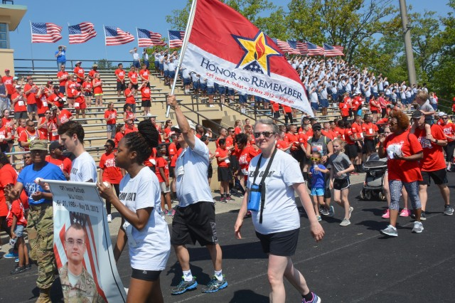 The family of Capt. Jesse Ozbat, who died in 2012, takes part of the survivors' first lap during Fort Lee's eighth annual Run for the Fallen at Williams Stadium May 12. More than 6,600 attended this year's event and ran 15,000 in honor of fallen military members. (Photo by Amy Perry, Fort Lee Public Affairs)
