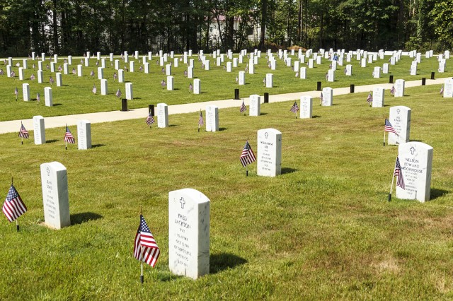 Anniston Army Depot employees, Soldiers and retirees from throughout Calhoun County placed flags on the 355 graves at McClellan Military Cemetery in honor of those interred there and members of the military who have made the ultimate sacrifice.