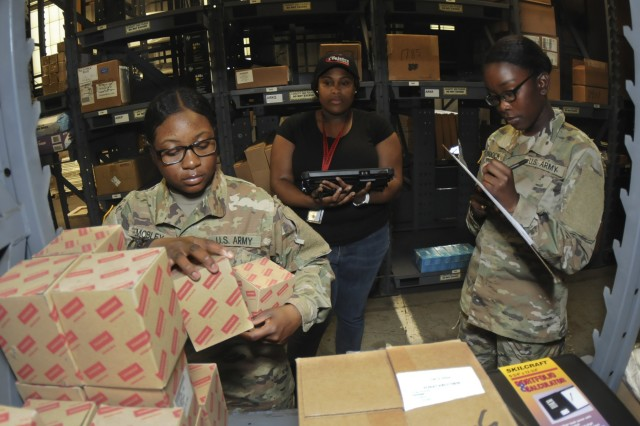 Advanced individual training students Pvt. Laren Mobley gathers supplies while Pvt. Alexis Murdock documents items removed from stock during a Global Combat Support System-Army training session included in the 92A Automated Logistical Specialist Course recently. GCSSA is a web-based logistics tracking and transaction program used throughout the Army, but training gaps have somewhat hindered how effective it can be.  A modified GCSSA training program that will be implemented this year should fill in those gaps, say administrators.