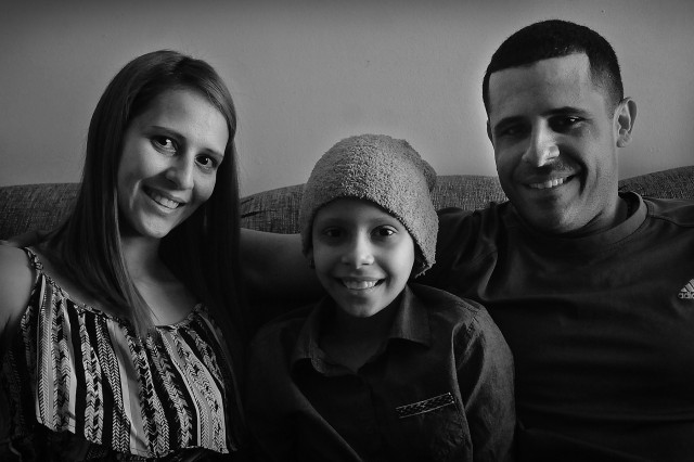 Pfc. Neftali Rios, with his wife, Jennifer and 9-year-old daughter Navila, are native Puerto Ricans who now call the mainland their home.