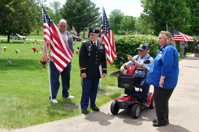 Col. Bradley Cook, inspector general for the U.S. Army Sustainment Command, is given a brief tour of the All Veterans Memorial at Davenport Memorial Gardens, Davenport, Iowa, before speaking at a Memorial Day observance, May 27. (Photo by Paul Levesque, ASC Public Affairs)