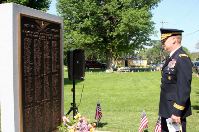 Maj. Gen. Duane Gamble, commanding general of the U.S. Army Sustainment Command, pauses to read a plaque listing local veterans at the Orion Veterans Memorial during a Memorial Day observance held in Orion, Illinois, May 28. (Photo by Rhys Fullerlove, ASC Public Affairs)