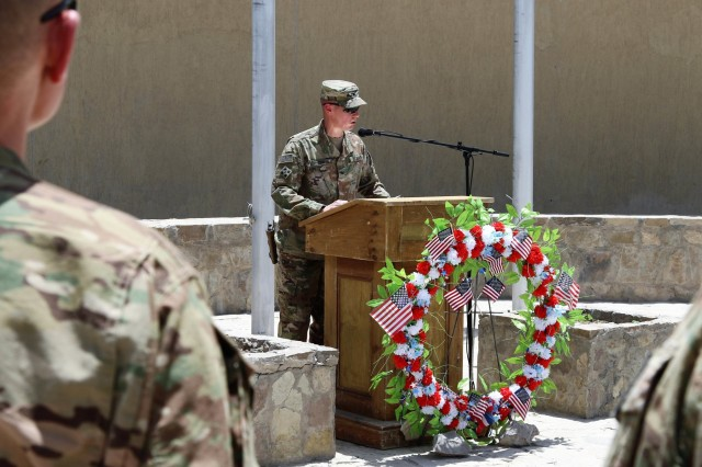 U.S. Army Col. Dave Zinn, deputy commander for Train, Advise, and Assist Command-South, delivers remarks during a Memorial Day observance at the TAAC-South Headquarters in Kandahar, Afghanistan, May 28, 2018.  During the ceremony Soldiers and contractors across Kandahar simultaneously observed a moment of silence, which was directed by the base announcement system. TAAC-South, commanded by Brig. Gen. John Lathrop, is composed of Soldiers from the 40th Infantry Division, California National Guard and the 2nd Infantry Brigade Combat Team, 4th Infantry Division. (U.S Army photo by Maj. Richard Barker/TAAC-South Public Affairs)