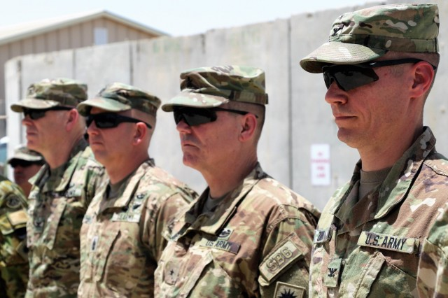 The leadership for Train, Advise, and Assist Command-South pay their respects with a moment of silence during a Memorial Day observance at the TAAC-South Headquarters in Kandahar, Afghanistan, May 28, 2018.  From left to right the TAAC-S leaders are: Chief of Staff Col. Peter Cross, Command Sgt. Maj. Anton Hillig, Commander Brig. Gen. John Lathrop, and Deputy Commander Col. Dave Zinn. TAAC-South, commanded by Brig. Gen. John Lathrop, is composed of Soldiers from the 40th Infantry Division, California National Guard and the 2nd Infantry Brigade Combat Team, 4th Infantry Division. (U.S Army photo by Maj. Richard Barker/TAAC-South Public Affairs)