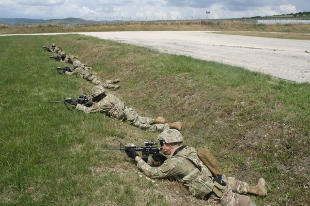 Soldiers react to direct fire during Advanced Rifle Marksmanship and Individual Movement Techniques training May 24 at Camp Marechal De Lattre De Tassigny, Kosovo.