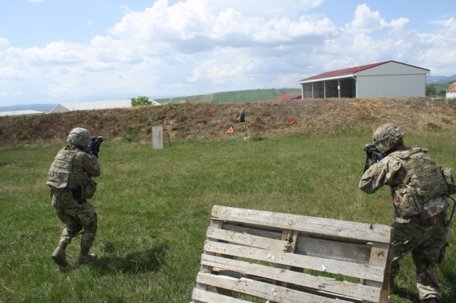 Soldiers assault the objective during Advanced Rifle Marksmanship and Individual Movement Techniques training May 24 at Camp Marechal De Lattre De Tassigny, Kosovo.