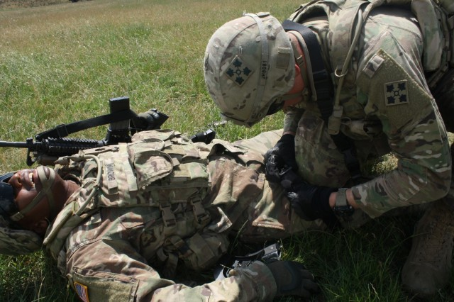 A Soldier simulates caring for a casualty during Advanced Rifle Marksmanship and Individual Movement Techniques training May 24 at Camp Marechal De Lattre De Tassigny, Kosovo.