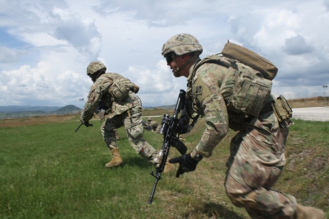 Soldiers bound forward toward the enemy during Advanced Rifle Marksmanship and Individual Movement Techniques training May 24 at Camp Marechal De Lattre De Tassigny, Kosovo.