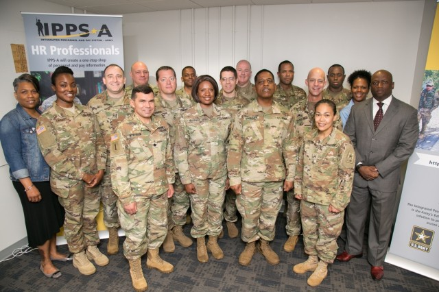 Pictured: Soldiers of the Army National Guard IPPS-A liaison team with program manager, Col. James (Darby) McNulty, IPPS-A Project Manager (right), Col. Gregory S. Johnson, IPPS-A Functional Management Division Chief (left) and Lt. Col. Robert Atkinson, ARNG Team Lead (left front).