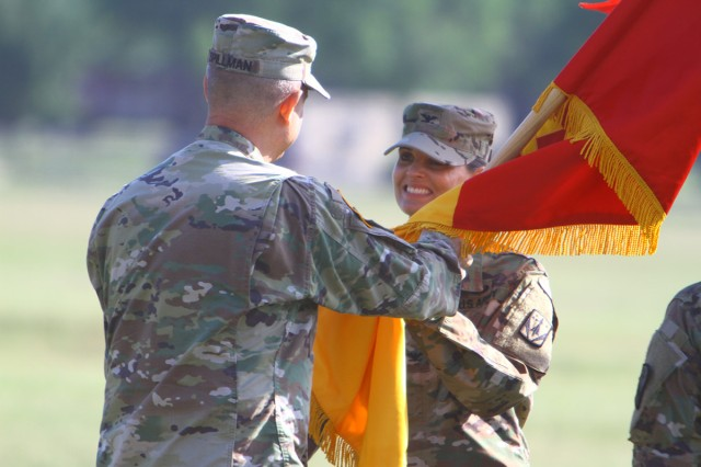 Brig. Gen. Christopher Spillman, 32nd Air and Missile Defense Command commanding general, passes the 31st ADA Brigade colors to Col. Lisa Bartel, symbolizing her taking command of the brigade May 23, 2018, at Lucas Polo Field. Bartel was most recently the deputy director of the Army chief of staff's coordination group at the Pentagon.