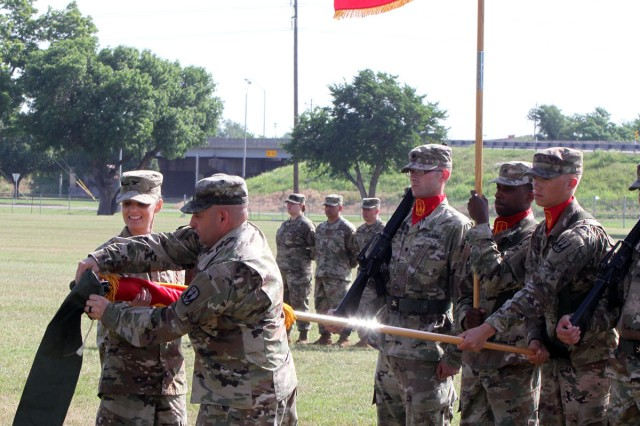 The 31st ADA Brigade command team of Col. Lisa Bartel and Command Sgt. Maj. Jerry Jacobitz case the unit colors as its Headquarters and Headquarters Battery will deploy in days to the Middle East.